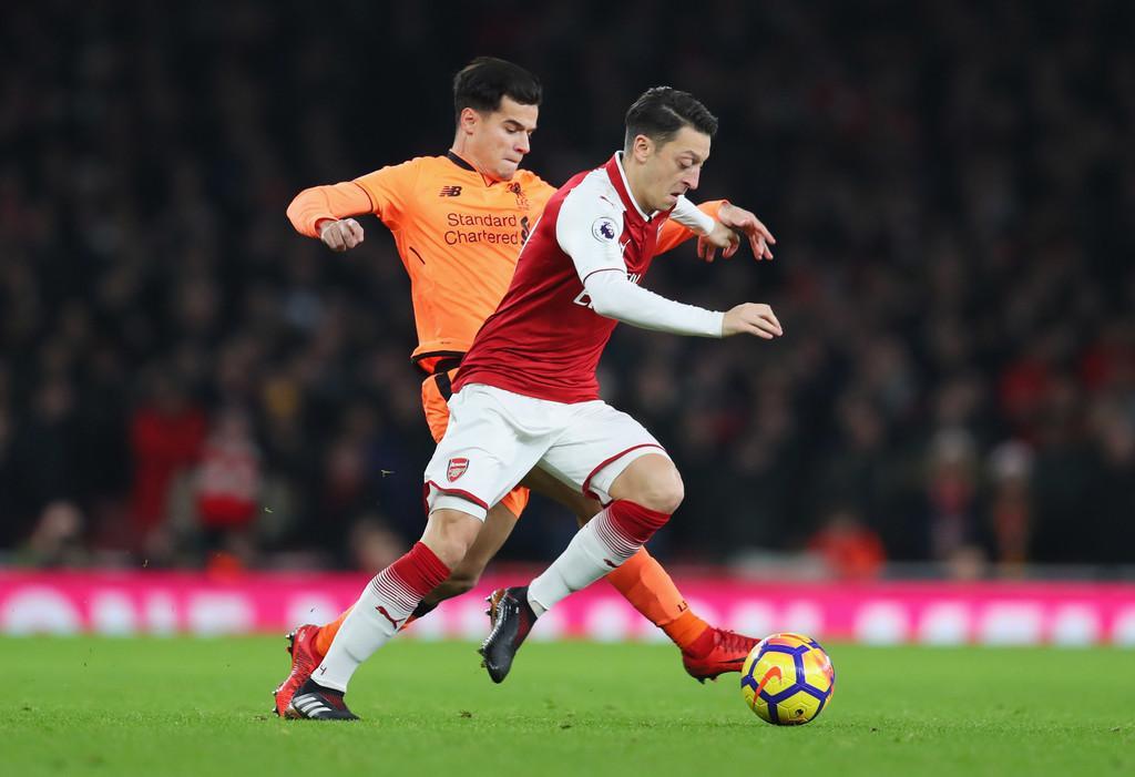Arsenal-v-Liverpool-coutinho-ozil