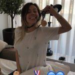 Alex-Telles-wife-Priscila-Minuzzo-with-medal